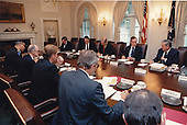 United States President George H.W. Bush meets with the National Security Council regarding Iraq's invasion of Kuwait. Participants are: Henson Moore, Deputy Secretary of Energy; William Webster, Director of the Central Intelligence Agency (CIA); U.S. Secretary of State James A.  Baker, III; Donald Atwood, Deputy Secretary of Defense; Richard Darman, Director, Office of Management and Budget (OMB); White House Chief of Staff John Sununu (not pictured);  Michael Boskin, Chairman, Council of Economic Advisors (not pictured); U.S. Attorney General Richard Thornburgh; U.S. Secretary of the Treasury Nicolas Brady; U.S. Vice President Dan Quayle, National Security Advisor General Brent Scowcroft; and General Colin Powell, Chairman, Joint Chiefs of Staff in the Cabinet Room of the White House in Washington, D.C. on August 6, 1990.<br /> Mandatory Credit: David Valdez / White House via CNP