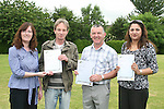 Sinead Fearon from the VEC presents Peter Donoghue, Michael Black and Sophia Waqar with their certificates for Computer Literacy at the presentation of certificates to successful participants of the Home School and Community Liaison Course....Photo NEWSFILE/Jenny Matthews.(Photo credit should read Jenny Matthews/NEWSFILE)....This Picture has been sent you under the condtions enclosed by:.Newsfile Ltd..The Studio,.Millmount Abbey,.Drogheda,.Co Meath..Ireland..Tel: +353(0)41-9871240.Fax: +353(0)41-9871260.GSM: +353(0)86-2500958.email: pictures@newsfile.ie.www.newsfile.ie.FTP: 193.120.102.198.