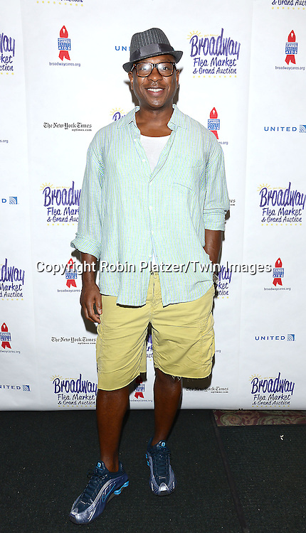 Alton Fitzgerald White attends the 28th Annual  Broadway Cares/ Equity Fights Aids Flea Market and Auction on September 21,2014 in Shubert Alley in New York City. <br /> <br /> photo by Robin Platzer/Twin Images<br />  <br /> phone number 212-935-0770