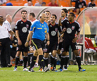Austin Da Luz (3) and Ethan White (15) of D.C. United argue with referee Jasen Anno during the game at RFK Stadium in Washington, DC.  D.C. United tied Toronto FC, 3-3.