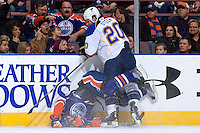 EDMONTON, CANADA - DECEMBER 4:  Alexander Steen #20 of the St. Louis Blues delivers a hit that upends a member of the Edmonton Oilers at Rexall Place on December 4, 2010 in Edmonton, Alberta, Canada.  (Photo by Andy Devlin/NHLI via Getty Images) *** LOCAL CAPTION *** Alexander Steen