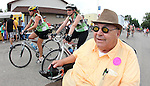 Gerald Lund, 75, dons a special pair of spectacles to watch RAGBRAI XXXVIII riders arrive in his hometown of Dike.
