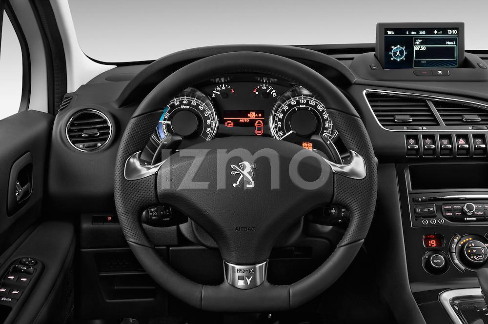 Steering wheel view of a 2012 - 2014 Peugeot 3008 Hybrid4 SUV.