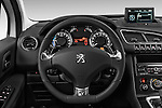 Steering wheel view of a 2012 - 2014 Peugeot 3008 Hybrid4 SUV.
