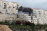 A picture taken from the West Bank city of Hebron on April 2, 2017 shows a view of the Kiryat Arba Jewish settlement on the outskirts of the Palestinian city. Photo by Wisam Hashlamoun