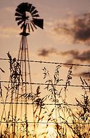 Kansas windpump next to barbed wire fence at sunet; PR#999. Abilene (near) Kansas, Dickenson County.