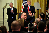 U.S. Secretary of State Mike Pompeo acknowledges the crowd as United States President Donald J. Trump met with Israel's Prime Minister Benjamin Netanyahu during a meeting in the East Room of the White House in Washington, D.C.,on Tuesday, January 28, 2020. Credit: Joshua Lott / CNP