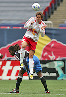 New York Red Bulls' Kevin Goldthwaite (2) goes for a header over San Jose Earthquakes' Gavin Glinton (9) in the first half of an MLS soccer match at Giants Stadium in East Rutherford, N.J. on Sunday, April 27, 2008. The Red Bulls defeated the Earthquakes 2-0.