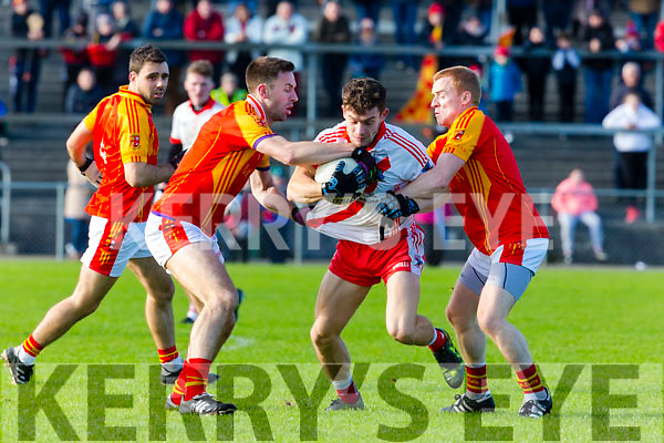 Tomas O'Sé An Ghaeltacht is tackled by John McGuinness  and Aaron Cahill Mallow during the Munster Intermediatte Championship semi final in Mallow on Sunday