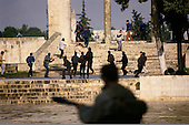 Jerusalem, Israel<br /> January 15, 1988<br /> <br /> Israeli soldiers move into the Dome of the Rock as Palestinian shout anti-Israeli slogans and burn Israeli and American flags after Friday ceremonies. Israel soldiers shoot tear gas into the Dome as young Palestinians throw rocks at the soldiers. Several police and at least 70 Palestinians are injured as the Israelis beat Palestinians with clubs during the 1 hour ordeal.