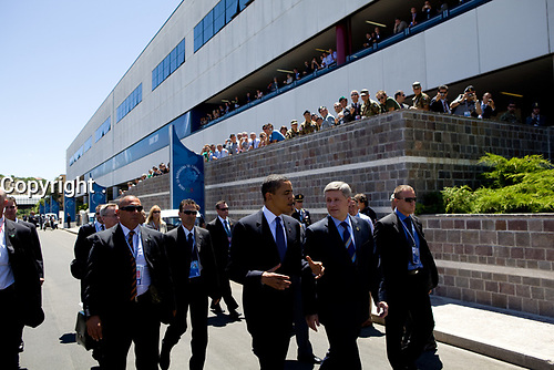 President Barack Obama and Canadian Prime Minister Stephen Harper walk around the G-8 site in L'Aquila, Italy, July 9, 2009.<br />  (Official White House Photo by Pete Souza)<br /> <br /> This official White House photograph is being made available for publication by news organizations and/or for personal use printing by the subject(s) of the photograph. The photograph may not be manipulated in any way or used in materials, advertisements, products, or promotions that in any way suggest approval or endorsement of the President, the First Family, or the White House.