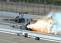 Feb 13, 2016; Pomona, CA, USA; NHRA top fuel driver Antron Brown (near) explodes an engine on fire alongside Brittany Force during qualifying for the Winternationals at Auto Club Raceway at Pomona. Mandatory Credit: Mark J. Rebilas-USA TODAY Sports
