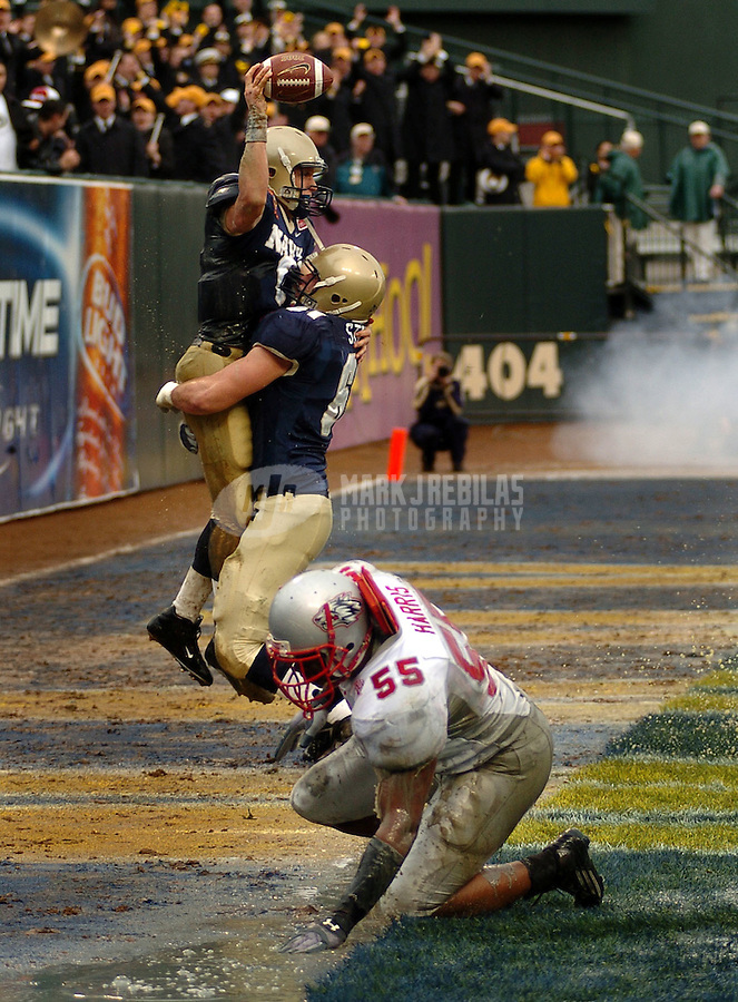 University of New Mexico Linebacker Chrishone Harris smacks the ground as Quarterback Aaron Polancois is lifted into the air after running the ball in for a touchdown in the Emerald Bowl in San Francisco, Calif. The Midshipmen of the U.S. Naval Academy (9-2) defeated the Lobos (7-4) of the University of New Mexico 34 to 19. Mandatory Credit: Mark J. Rebilas.