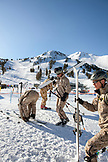 USA, California, Mammoth, a group of camouflaged skiers get ready to hit the slopes