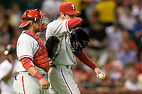 Philadelphia Phillies catcher Carlos Ruiz #51 talks to pitcher Cole Hamels during the Major League Baseball game against the Houston Astros at Minute Maid Park in Houston, Texas on September 13, 2011. Houston defeated Philadelphia 5-2.  (Andrew Woolley/Four Seam Images)