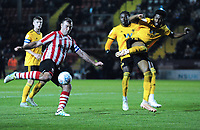 Lincoln City's Matt Rhead under pressure from Wolverhampton Wanderers U21's Cameron John<br /> <br /> Photographer Andrew Vaughan/CameraSport<br /> <br /> The EFL Checkatrade Trophy Northern Group H - Lincoln City v Wolverhampton Wanderers U21 - Tuesday 6th November 2018 - Sincil Bank - Lincoln<br />  <br /> World Copyright © 2018 CameraSport. All rights reserved. 43 Linden Ave. Countesthorpe. Leicester. England. LE8 5PG - Tel: +44 (0) 116 277 4147 - admin@camerasport.com - www.camerasport.com