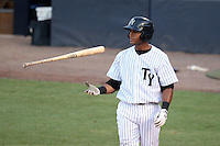 Tampa Yankees outfielder Zoilo Almonte #46 flips his bat during a game against the Clearwater Threshers at Steinbrenner Field on June 22, 2011 in Tampa, Florida.  The game was suspended due to rain in the 10th inning with a score of 2-2.  (Mike Janes/Four Seam Images)