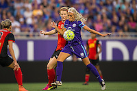 Orlando, Florida - Sunday, May 14, 2016: Orlando Pride midfielder Kaylyn Kyle (6) shields the ball from Western New York Flash midfielder Samantha Mewis (5) during a National Women's Soccer League match between Orlando Pride and New York Flash at Camping World Stadium.