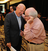 NWA Democrat-Gazette/ANDY SHUPE<br /> Chuck Barrett (left), voice of the Razorbacks, speaks Friday, Aug. 18, 2017, with Dick Trammel, former Arkansas cheerleader and banker, before the start of the Kickoff Luncheon at the Northwest Arkansas Convention Center in Springdale. Visit nwadg.com/photos to see more photographs from the luncheon.