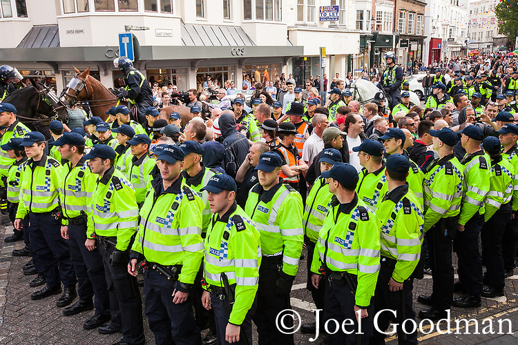 © Joel Goodman - 07973 332324 . 02/06/2012 . Brighton , UK . Police surround groups of nationalists , including supporters of March for England and the EDL , congregated in Brighton , as anti-fascist and left-wing campaigners supporting UK Uncut also congregate . An intensive policing operation is deployed to separate opposing left and right wing groups . Photo credit: Joel Goodman