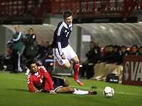 Matthew LKennedy tackled by Aram Shakhnazaryan in the Scotland v Armenia UEFA European Under-19 Championship Qualifying Round match at New Douglas Park, Hamilton on 9.10.12.