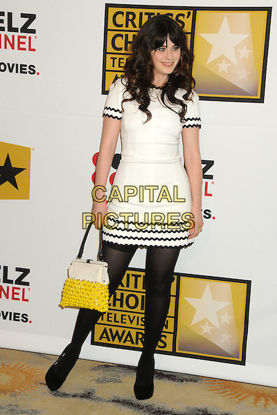 Zooey Deschanel.1st Annual Critics' Choice Television Awards held at The Beverly Hills Hotel, Beverly Hills, California, USA, .20th June 2011..full length tights dress rick rack yellow bag handbag white black fringe smiling .CAP/ADM/BP.©Byron Purvis/AdMedia/Capital Pictures.
