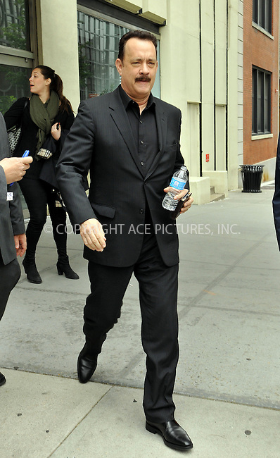 WWW.ACEPIXS.COM....May 28 2013, New York City....Actor Tom Hanks leaves a TV studio in Midtown Manhattan on May 28 2013 in New York City......By Line: Romeo/ACE Pictures......ACE Pictures, Inc...tel: 646 769 0430..Email: info@acepixs.com..www.acepixs.com