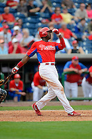 Philadelphia Phillies outfielder Domonic Brown #9 hits a home run during a Spring Training game against the New York Yankees at Bright House Field on February 26, 2013 in Clearwater, Florida.  Philadelphia defeated New York 4-3.  (Mike Janes/Four Seam Images)