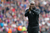 West Brom caretaker manager, Darren Moore applauds fans during the EPL - Premier League match between Crystal Palace and West Bromwich Albion at Selhurst Park, London, England on 13 May 2018. Photo by Carlton Myrie / PRiME Media Images.