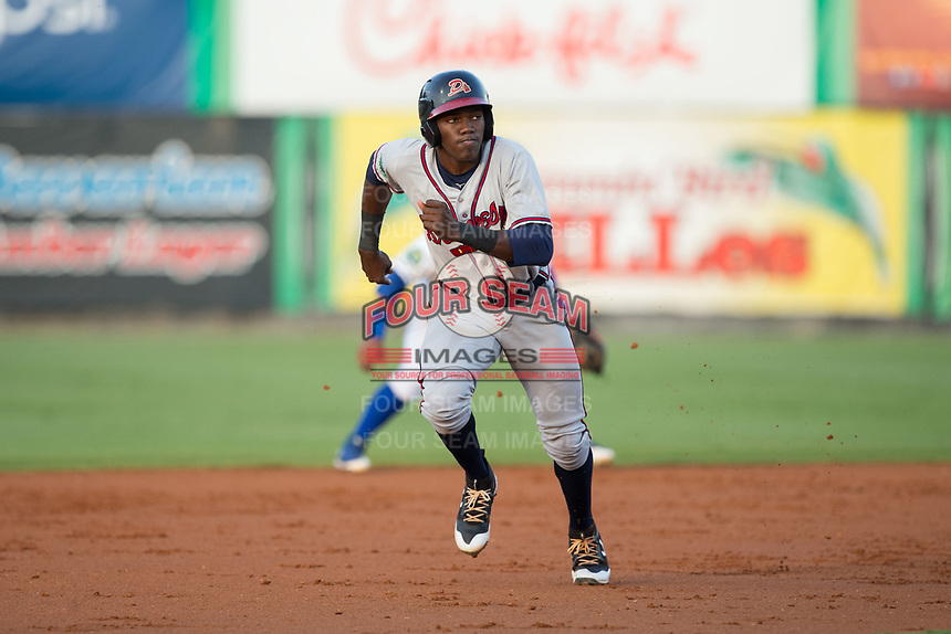 Jan Carlos Encarnacion (8) of the Danville Braves takes takes off for third base against the Burlington Royals at Burlington Athletic Stadium on August 14, 2017 in Burlington, North Carolina.  The Royals defeated the Braves 9-8 in 10 innings.  (Brian Westerholt/Four Seam Images)
