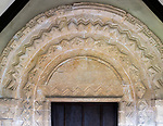 Elaborately decorated stone 12th century Norman arch in doorway entrance to the historic village parish church  Marden, Wiltshire, England, UK