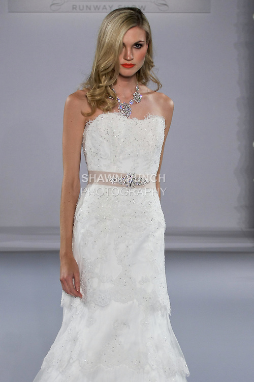 Model walks runway in a Dallyn wedding dress from the Maggie Sottero Spring 2013 Bridal collection, for the Couture Runway Show, during New York Bridal Fashion Week at The Hilton Hotel, October 13, 2012.