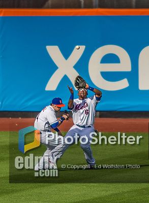 20 April 2013: New York Mets outfielder Marlon Byrd pulls in a fly ball as Collin Cowgill avoids a collision during play against the Washington Nationals at Citi Field in Flushing, NY. The Mets fell to the visiting Nationals 7-6, tying their 3-game weekend series at one a piece. Mandatory Credit: Ed Wolfstein Photo *** RAW (NEF) Image File Available ***