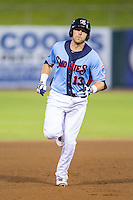 Dustin Geiger (13) of the Tennessee Smokies rounds the bases after hitting a home run against the Mississippi Braves at Smokies Park on July 22, 2014 in Kodak, Tennessee.  The Smokies defeated the Braves 8-7 in 10 innings. (Brian Westerholt/Four Seam Images)