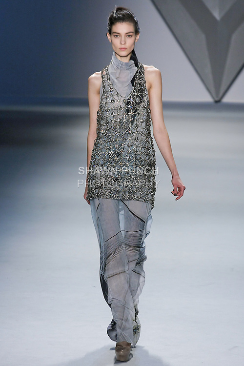 Kati Nescher walks runway in a column print silk chiffon halter cowl neck gown with plunging back and crystal mesh racerback tank overlay over silk chiffon boy short, from the Vera Wang Fall 2012 Vis-a-gris collection, during Mercedes-Benz Fashion Week Fall 2012 in New York.