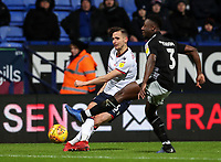 Bolton Wanderers' Pawel Olkowski crosses under pressure from Reading's Andy Yiadom  <br /> <br /> Photographer Andrew Kearns/CameraSport<br /> <br /> The EFL Sky Bet Championship - Bolton Wanderers v Reading - Tuesday 29th January 2019 - University of Bolton Stadium - Bolton<br /> <br /> World Copyright © 2019 CameraSport. All rights reserved. 43 Linden Ave. Countesthorpe. Leicester. England. LE8 5PG - Tel: +44 (0) 116 277 4147 - admin@camerasport.com - www.camerasport.com