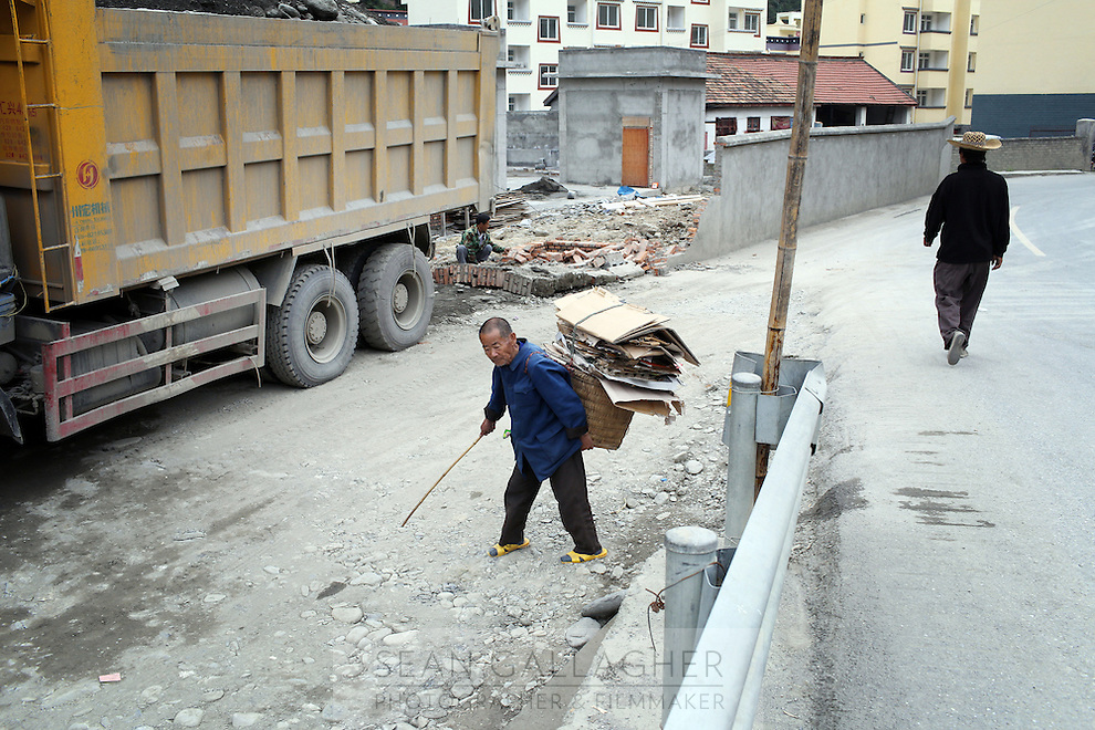 A man collecting cardboard in the town of Heishui on the south-east edge of the Tibetan Plateau in Sichuan Province, western China.