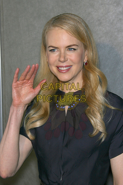 "NICOLE KIDMAN.""God Grew Tired of Us"" Los Angeles Premiere - Arrivals held at The Pacific Design Center, Los Angeles, California, USA, 8 January 2007..half length grey long dress hand waving.CAP/ADM/ZL.©Zach Lipp/Admedia/Capital Pictures"