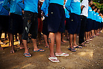 Drug abusers stand attention during the raising of the Cambodian flag, at Orkas Khnom, or My Chance, a government-run facility where youth and young men are brought here by their families or by arrest from police to be re-educated from drug addiction, just outside Phnom Penh, Cambodia, on Tuesday, May 11, 2010.