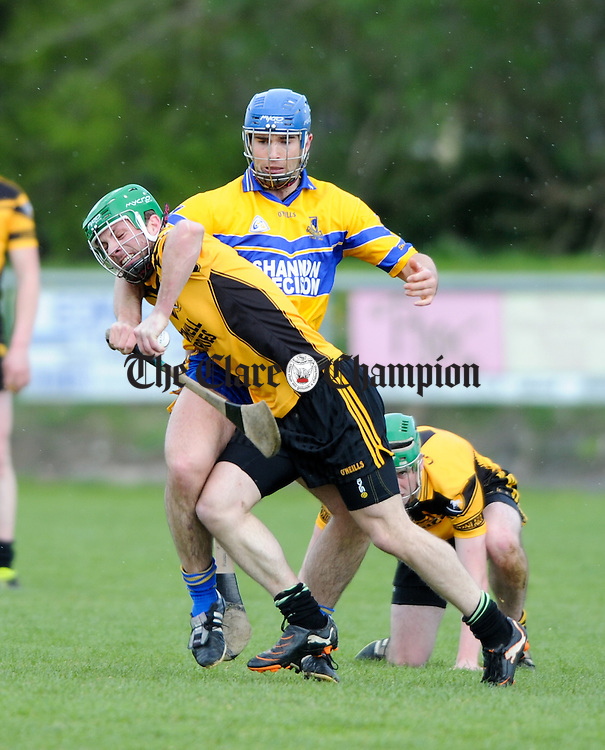 William Slattery of Clonlara in action against Caimin Morey of Sixmilebridge during their Clare Champion Cup game at Sixmilebridge. Photograph by John Kelly.