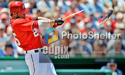16 June 2012: Washington Nationals' catcher Jesus Flores gets a broken-bat, 2-RBI double in the bottom of the second inning opening the scoring against the New York Yankees at Nationals Park in Washington, DC. The Yankees defeated the Nationals in 14 innings by a score of 5-3, taking the second game of their 3-game series. Mandatory Credit: Ed Wolfstein Photo