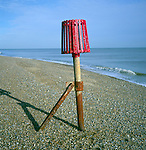 Red marker used to identify the end of a groyne, shingle beach, Aldeburgh, Suffolk, England