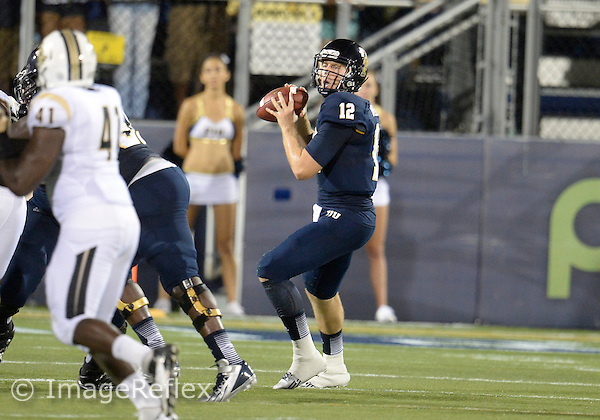 Florida International University football player quarterback Jake Medlock (12) plays against the University of Central Florida on September 6, 2013 at Miami, Florida. Central Florida won the game 38-0.