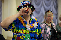 Moscow, Russia, 24/09/2010..Russian competitor gastroenterologist Doctor Fedor Rytikov knocks back a vodka before going onstage in the semi-finals of the Karaoke World Championships 2010, where amateur singers from around the world competed for prizes that included one million Russian dumplings.
