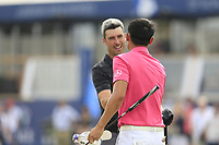 Ross Fisher (ENG) and Haotong Li (CHN) on the 18th green during the 3rd round of the DP World Tour Championship, Jumeirah Golf Estates, Dubai, United Arab Emirates. 17/11/2018<br /> Picture: Golffile | Fran Caffrey<br /> <br /> <br /> All photo usage must carry mandatory copyright credit (© Golffile | Fran Caffrey)