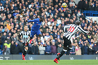 Ngolo Kante of Chelsea heads the ball clear during the Premier League match between Chelsea and Newcastle United at Stamford Bridge, London, England on 2 December 2017. Photo by David Horn.