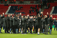 Manchester City manager Pep Guardiola and his staff applaud the team as they lift the Trophy.  Aston Villa vs Manchester City, Caraboa Cup Final Football at Wembley Stadium on 1st March 2020