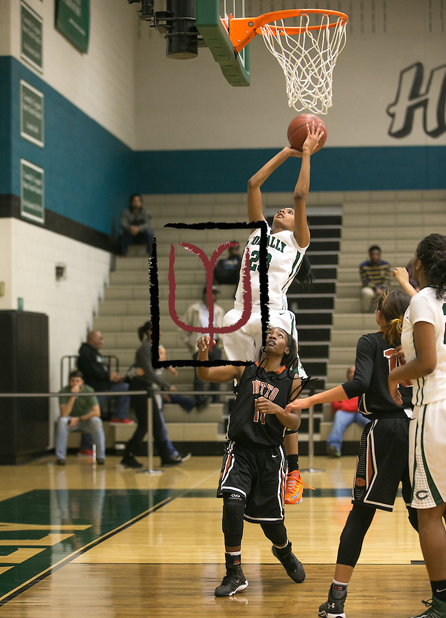 Connally's Zhartaezia Bradley attempts a shot over Hutto Friday at Cougar Gym. The Lady Cougars lost to the Hutto Hippos 54-42.  (LOURDES M SHOAF for Round Rock Leader.)