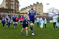 Elliott Stooke of Bath Rugby mascot in hand runs out onto the field. Gallagher Premiership match, between Bath Rugby and Harlequins on March 2, 2019 at the Recreation Ground in Bath, England. Photo by: Patrick Khachfe / Onside Images
