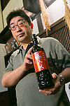 Isawa Heizo, President of Katsuyama Supreme SAKE Co., Ltd. poses for the cameras during a tour to members of the press as part of the ''1000km Relay to Tokyo 2016'' promotion event in Sendai City on July 30, 2016, Miyagi, Japan. The sake brewery factory received the Gold Medal of Junmai Ginjo category at the International Wine Challenge 2016 Award for its flagship sake ''Akatsuki'' on July 29, 2016. The sake brewery was established over 320 years ago and is expanding to market their products overseas. (Photo by Rodrigo Reyes Marin/AFLO)